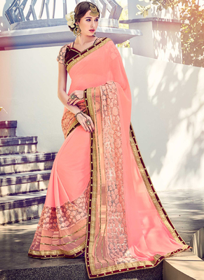 Baby pink embroidered chiffon saree with blouse