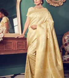 Buy Cream woven kanchipuram silk saree with blouse kanchipuram-silk-saree online