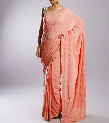 Designer peach color crepe sari with silver booties without blouse