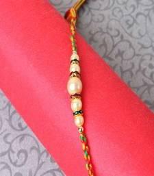 Buy Pearl Beads Rakhi pearl-rakhi-design online