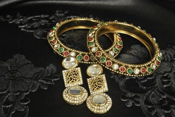 Gold Plated Handcrafted Kundan Earrings & Multicoloured Gold Plated Bangles