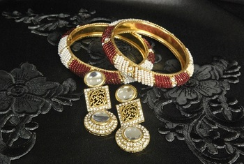 Gold Plated Handcrafted Kundan Earrings with Red colour Bead Bangles set