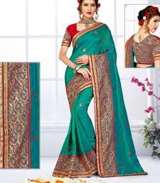 Buy Teal hand woven silk saree with blouse silk-saree online