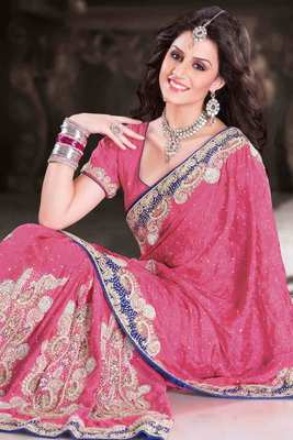 Pink georgette Weaved & stone worked saree in royal blue border