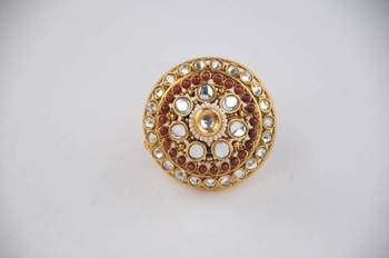 Adjustable Polki ring with Kundan and Maroon and White stones.