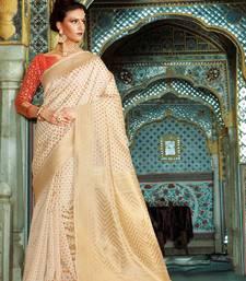 Buy Beige woven banarasi silk saree with blouse banarasi-silk-saree online