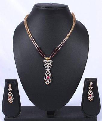 Gold Brown Pink American Diamond Pendant Set