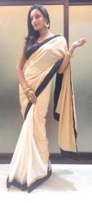beige and white saree