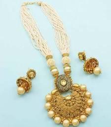 Buy Golden Beige Polki Stones Pendant Set Jewellery for Women necklace-set online