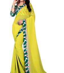 Buy Yellow plain georgette saree with blouse below-1500 online