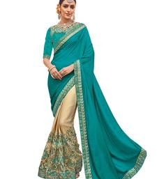 Buy Green woven silk blend saree with blouse silk-saree online
