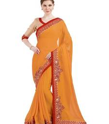 Buy Indian women orange designer patch and stone and floral design Raw Silk saree with blouse chiffon-saree online