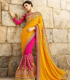 Buy Dark hot pink embroidered pure georgette saree with blouse designer-embroidered-saree online