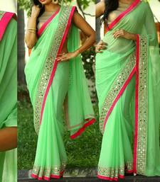 Buy Parrot green plain georgette saree with blouse georgette-saree online