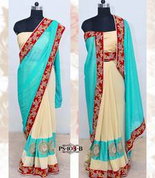 Buy Cream & Sea green Embroidered border saree with unstitched blouse fancy-saree online