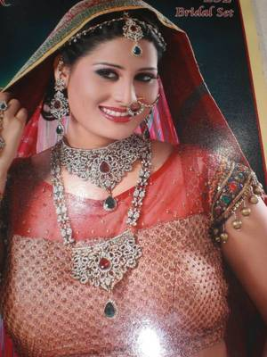 Complete traditional kundan bridal set in the indian colors of red & green