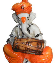 Buy Polyresine Ganesha Playing Dholak Idol sculpture online