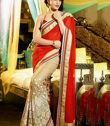 Buy beige and red embroidered net saree with blouse bollywood-saree online