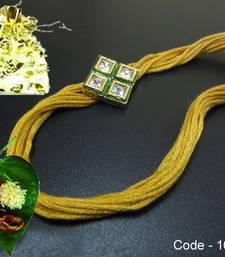 Buy Golden AD Kundan Rakhi rakhi-gift-hamper online