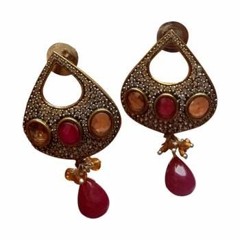 A pair of Ruby red coloured earrings